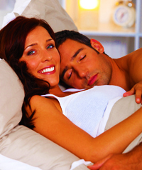Couple in Bed Together After Using a Medical (USP) Lanolin Skin Serum to Soften and Moisturize Their Skin