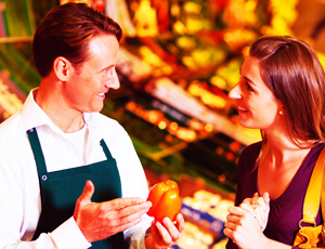 Grocer Speaking With Woman Customer