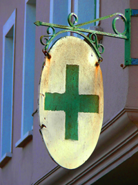 Old German Pharmacy Sign With Green Cross