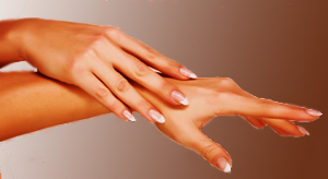 Woman Rubbing Lanolin on Her Hands to Soften Skin, Nails, and Cuticles